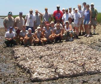 Volunteers with completed reef